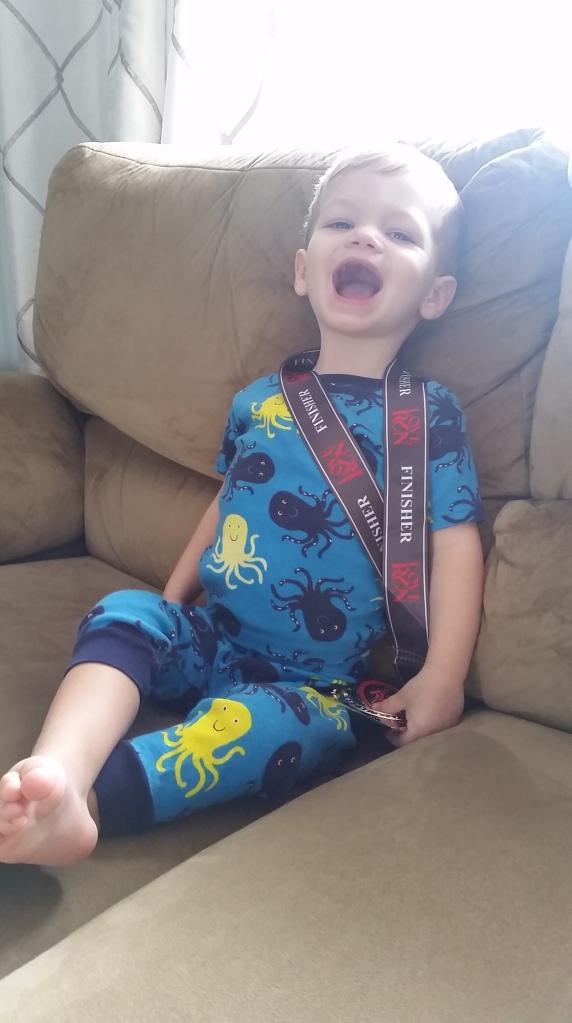 Harry loves Mama's medal!